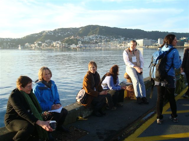 delegates enjoy early morning harbour walk